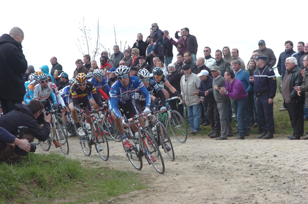 Matteo Tossatto leads Tom Boonen