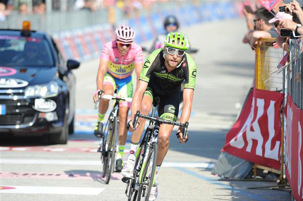 Ryder Hesjedal and Alberto Contador finish stage 18