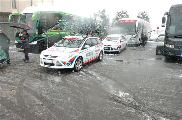 team cars and busses in the snow