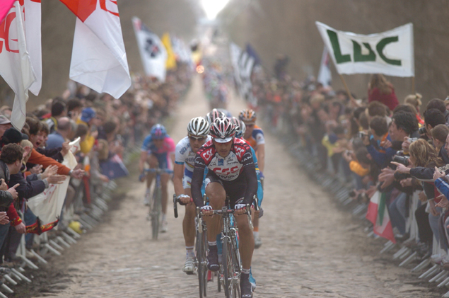 Fabian Cancellara leads through the arenberg forest